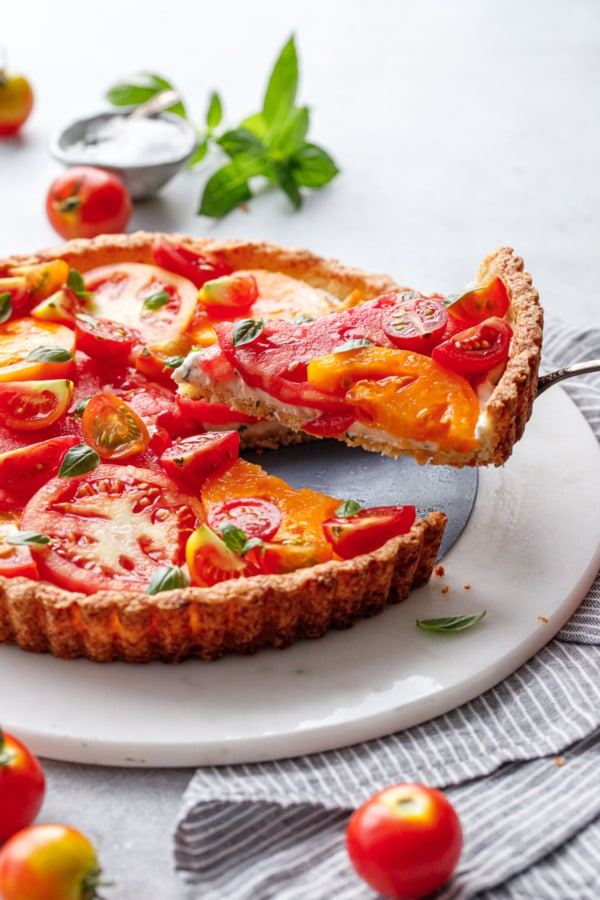 Lifting a slice of heirloom tomato tart