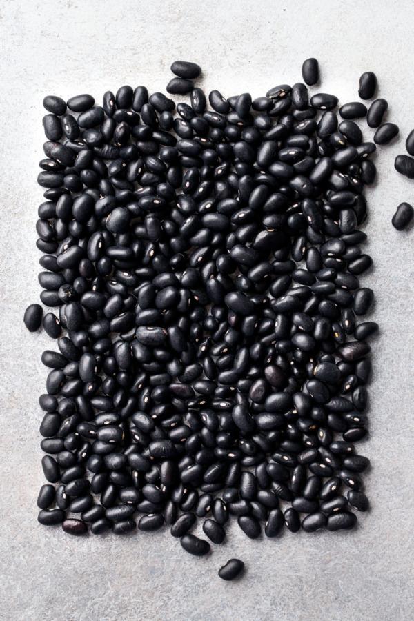 Artistic arrangement of dry black beans in a rectangular shape
