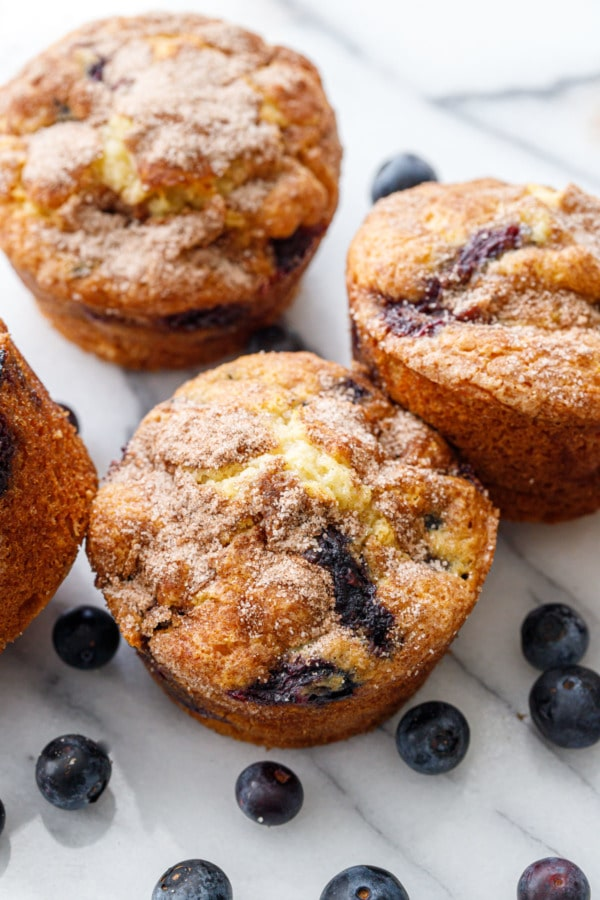 Golden brown blueberry coffee cake muffins on marble