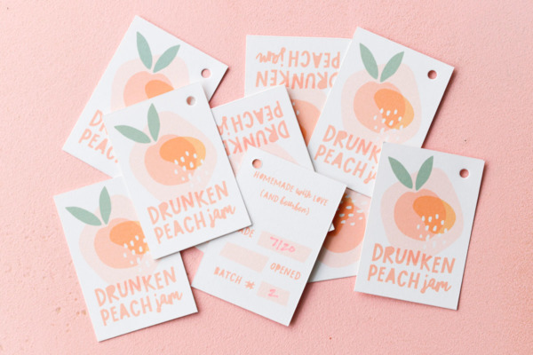 Printable hang tag labels for Drunken Peach Jam, showing front and back designs on a pink background.