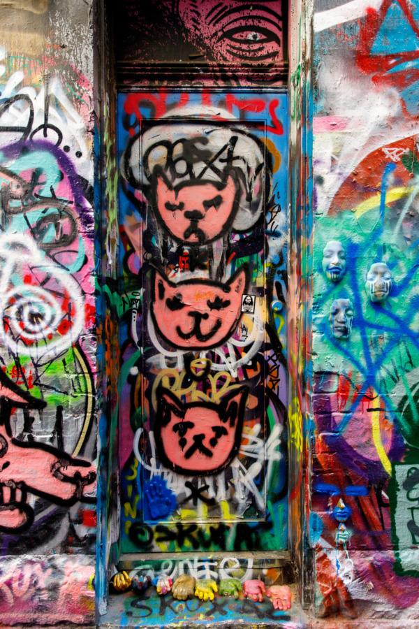 Graffiti of three cat faces, Hosier Lane, Melbourne, Australia