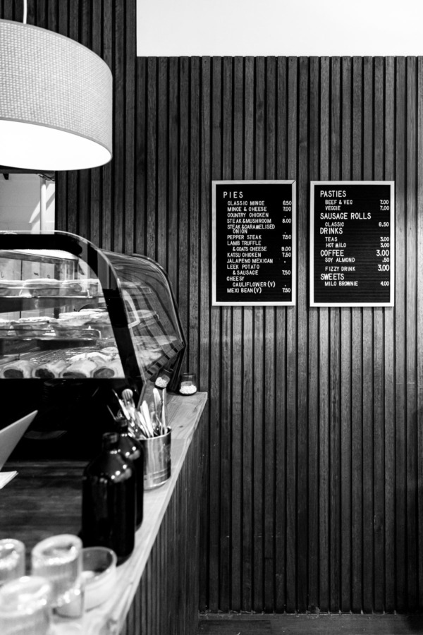 Interior of Prince's Pies with letterboard menus, Melbourne, Australia