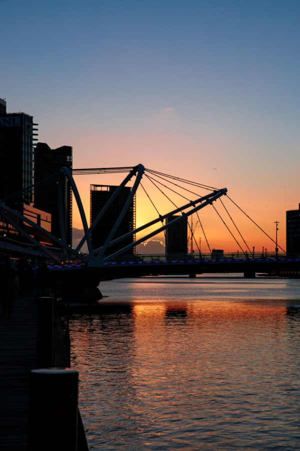 Sunset along the riverfront with silhouette of bridge, Melbourne, Australia