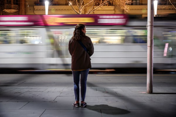 Motion blur tram, Lindsay standing still in the foreground, Melbourne, Australia