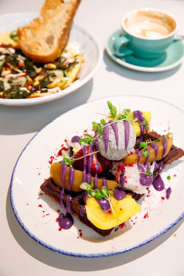 Beautiful brunch presentation: Ube waffles and okonomiyaki omelet from Operator25 in Melbourne, Australia