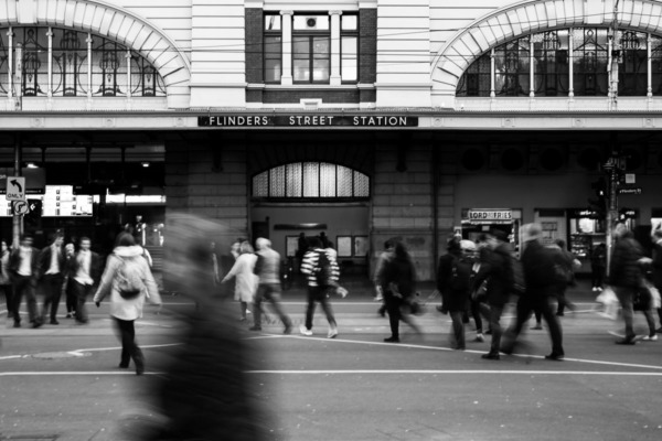 Black and white with blurred people in motion, Flinders Street Station, Melbourne, Australia