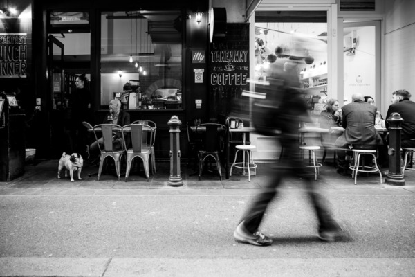 Cafe in Melbourne, Australia with motion-blurred people walking by