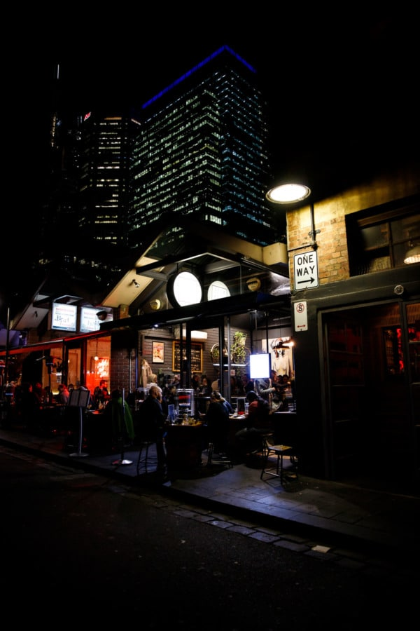 Nighttime cafe scene with skyscrapers in the background, Melbourne, Australia