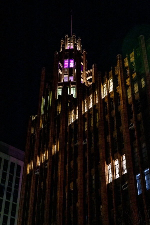 Art Deco building with colorful accent lights at night, Melbourne, Australia