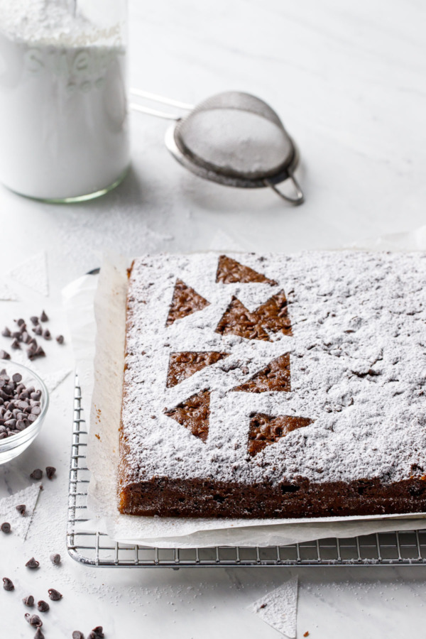 Powdered sugar dusted snack cake with abstract triangle design