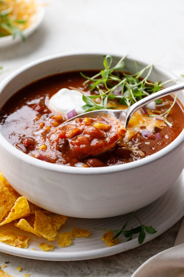 Spoonful of Vegetarian Pumpkin & Three-Bean Chili showing chunky texture