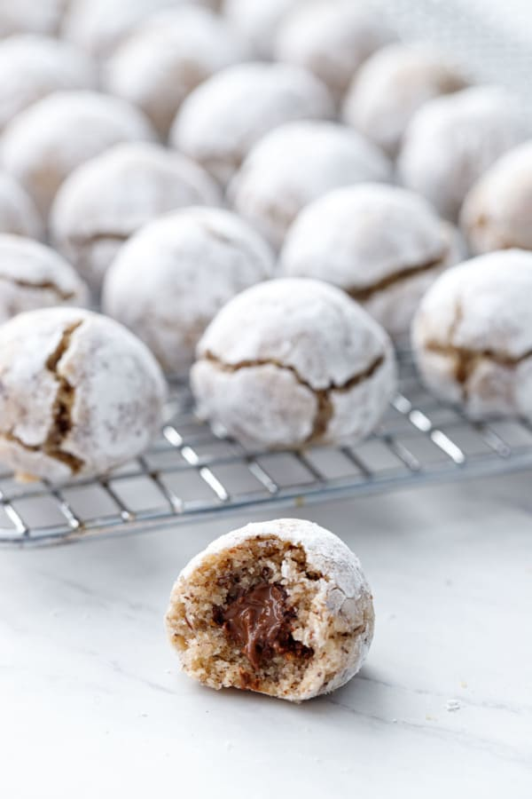 Closeup of a Hazelnut Amaretti Cookie with a bite, showing the Nutella filling inside