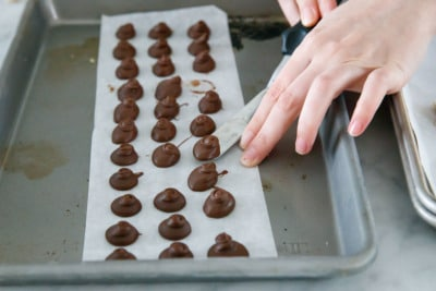 Dollops of frozen nutella on a baking sheet