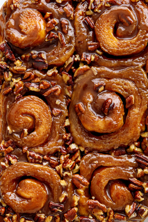 Closeup overhead of sticky buns showing spirals and pecans