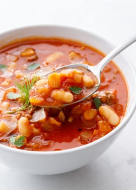 Closeup, spoonful of Pasta e Fagioli soup