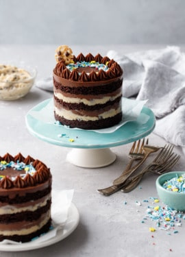Two Mini Chocolate & Cookie Dough Naked Layer Cakes on a gray background