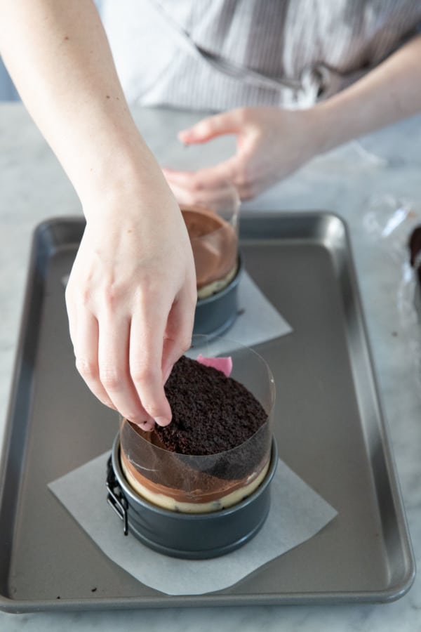 Assembling the naked cake in a cake ring lined with acetate