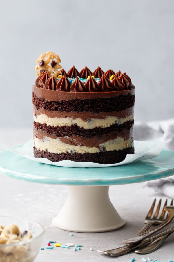One Mini Chocolate & Cookie Dough Naked Layer Cake on a turquoise cake stand