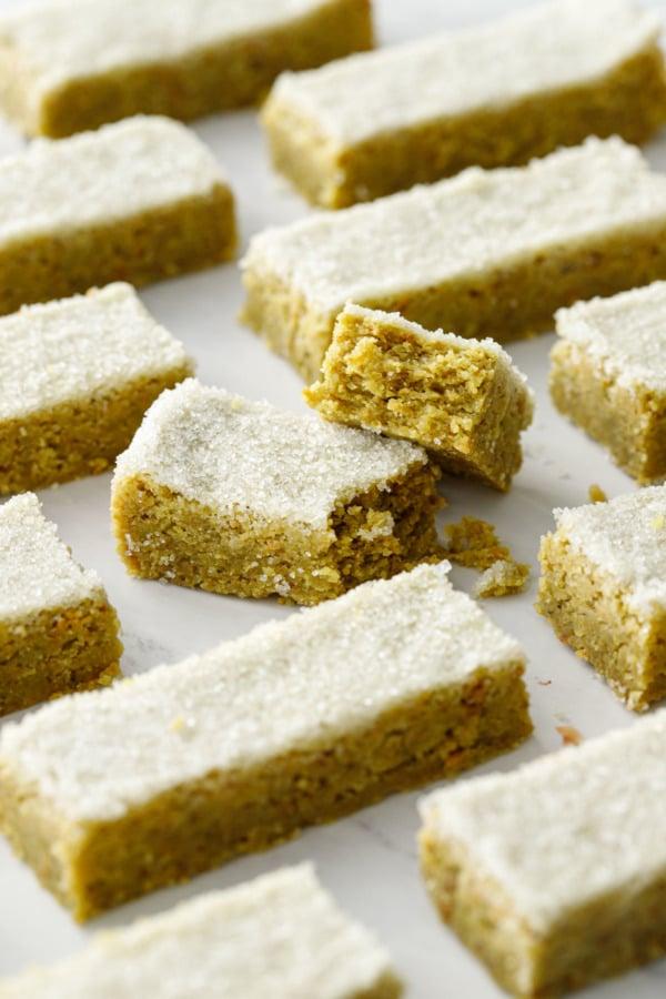 Geometric arrangement of rectangular cut cookies, one cookie broken in half to show texture
