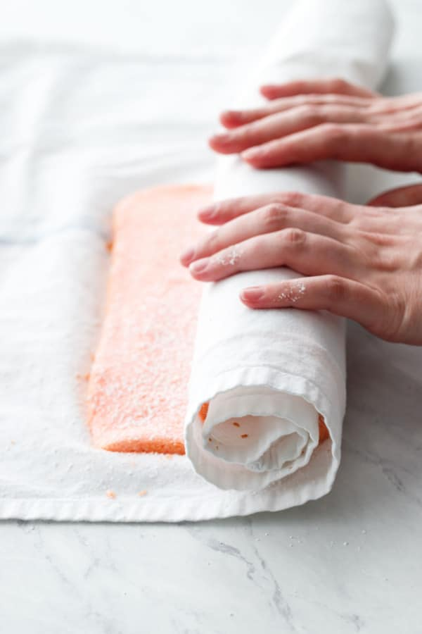 Rolling the warm cake up in a tea towel to prevent cracking