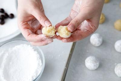 Step 1: Split each ball of dough in half.
