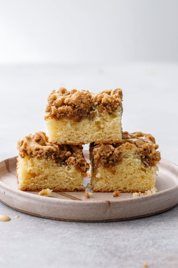 Straight on view of pyramid stack of cut coffee cake slices, showing the cake and crumb layers